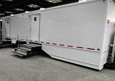 Shower and Restroom Trailer Rentals 10SADARTExterior 400x284 - 10 Station Restroom Trailer