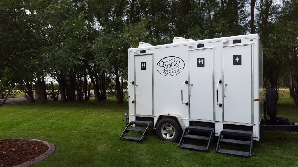 Shower and Restroom Trailer Rentals 4 Stall Restroom Lawn 1024x576 - Why you'll feel good renting a restroom trailer for your event.