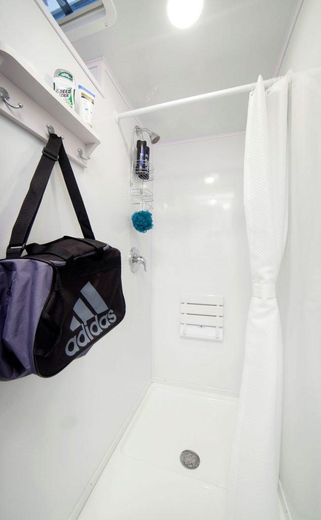 Shower and Restroom Trailer Rentals Shower Trailer Stall 633x1024 - Shower Trailer FAQ