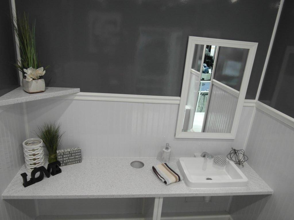 Shower and Restroom Trailer Rentals 3 stall ada restroom interior3 1024x768 - Handicap Accessible ADA Restroom Trailers